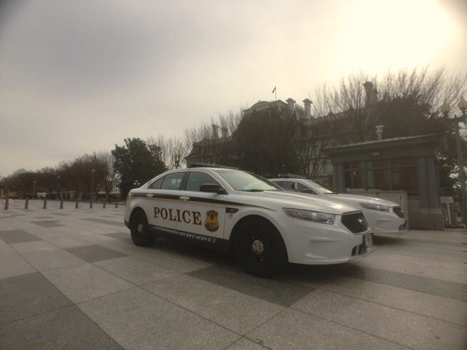 Secret service police cars parked at the old executive building in Washington DC